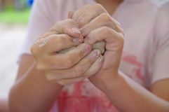 Pottery child hands. Children learning to make pottery out side Royalty Free Stock Photo