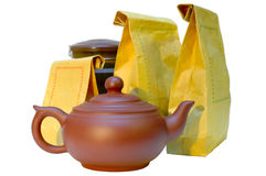 Pottery (clay) teapot, tea in paper bags and tin. Stock Photography
