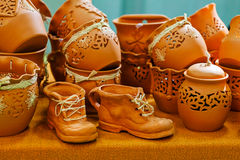 Pottery. Clay vases and shoes, pots for flowers Royalty Free Stock Images