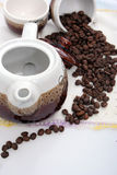 Pottery with coffee beans Stock Photos