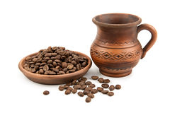 Pottery and coffee beans Royalty Free Stock Photo