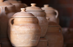 Pottery. A collection of pottery with light coming from the side. Deep shodow behind. Selective focus on part of the surface Stock Photos