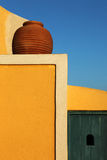 Pottery on colored wall, Santorini Royalty Free Stock Photography