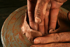 Pottery craftmanship clay pottery hands work. Pottery craftmanship red clay potter hands work finger closeup royalty free stock photos