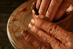 Pottery craftmanship clay pottery hands work. Pottery craftmanship red clay potter hands work finger closeup stock image