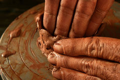 Pottery craftmanship clay pottery hands work. Pottery craftmanship red clay potter hands work finger closeup stock photo