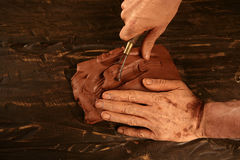 Pottery craftmanship potter hands work clay. Pottery craftmanship potter craftman hands working red clay royalty free stock photography