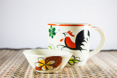 Pottery cup and small bowl painting Royalty Free Stock Images