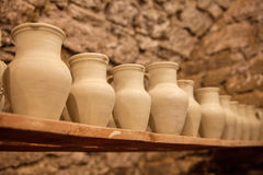 Pottery dishes on shelves. In pottery workshop, editorial photo Stock Image