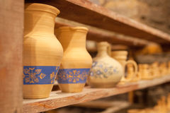 Pottery dishes on shelves Stock Image
