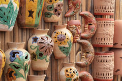 Pottery Display. Angled view of decorative pottery hanging on a wooden fence Royalty Free Stock Images