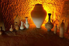 Pottery displayed in cave factory Royalty Free Stock Photography