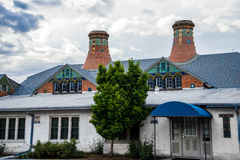Pottery factory colorado springs landmark. Vintage pottery factory with ornate smoke stacks - old world classic architecture colorado springs landmark royalty free stock photography