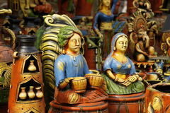 Pottery Figures. Collection of colorful pottery statues for sale at a craft market near Delhi, India Royalty Free Stock Photography