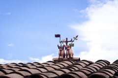 Pottery figures on a roof, Cusco. Mitological decorative pottery bulls on a red roof in Cusco, Peru Stock Images