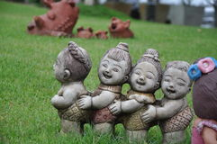 Pottery figurine on the grass Royalty Free Stock Photo