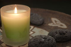 Pottery and fire. Pottery and candle with stones Stock Images