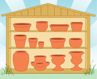 Pottery in a Garden Shed. Collection of clay flowerpots in a wooden garden barn: standard clay flowerpot, bulb pan, azalea pot, bonsai container, round and Royalty Free Stock Photos