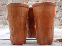 Pottery glasses. Three pottery glasses placed outside Royalty Free Stock Images