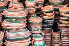 Pottery. Hand made and hand colored ceramic pots Stock Photos