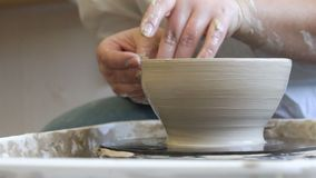 Pottery skill traditional art potter modeling clay. Pottery handicraft skills. traditional art of creating ceramics. potter modeling clay on turning wheel stock video footage