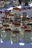 Pottery. Handmade decorated pottery exposed at a pottery fair in Sibiu, Romania stock photo