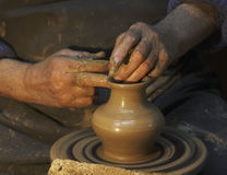 Pottery. Hands of a potter who makes a jug of clay.Craft Stock Images