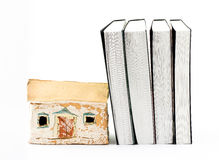 Pottery house and four small books. A pottery house and four miniature books stock photography
