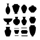 Pottery icon set. Stock vector illustration of classic pot and bowl black silhouettes. Handmade ceramic vase and jar Stock Photo