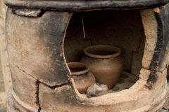 Pottery kiln. Old pottery kiln and pot. Pottery theme royalty free stock images