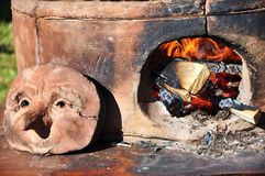Pottery kiln detail. Detail of a pottery kiln and fire Stock Image
