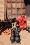 Pottery Making, Bhaktapur, Nepal. Woman arranging pots for sun drying at a small scale traditional pottery making industry in Bhaktapur, Nepal Stock Image