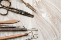 Pottery making tools. On a white desk Royalty Free Stock Images