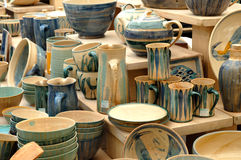 Pottery on the market. Pottery market - dishware in green Royalty Free Stock Photos