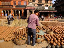 Pottery objects are sundried and displayed for sales in Bhaktapur Durbar Square, Kathmandu. Royalty Free Stock Image