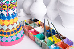 Pottery painting studio consists of palette, brushes, and unfinished peices Royalty Free Stock Photos