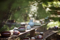 Pottery Pieces lining an outdoor shelf Royalty Free Stock Images