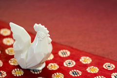 Pottery rooster on the Japanese handmade paper Stock Photography