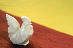 Pottery rooster on the Japanese handmade paper Royalty Free Stock Photography