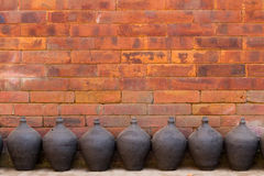 Pottery row and brick wall Stock Images