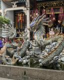 Pottery sculpture of dragon, carp and turtle in a fountain in the Cantonese Assembly Hall in Hoi An. stock photography
