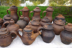 Pottery. Self-made pottery ( jug, kettle, pot, cover, Jug) decorated by old Stock Images