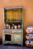 Pottery Shelves. A worn, wooden shelf holds pottery in Santa Fe, NM Stock Image