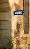 Pottery sign Sandstone wall Old Building detail Stock Photo