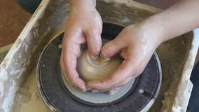 Pottery skill traditional art potter modeling clay. Pottery handicraft skills. traditional art of creating ceramics. potter modeling clay on turning wheel stock video