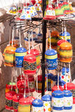 Pottery souvenirs hanging outside a shop in Mijas Stock Photography