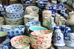 Pottery stall at the Hoi An Market, Vietnam. Includes locally made bowls, tea pots, salt and pepper shakers Stock Photo