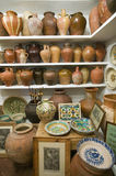 Pottery store shows stacks of old pots in old part of Centro, Sevilla Spain Stock Photo