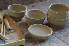 Pottery studio. Wheel thrown bowls at my studio. Dry terracotta ceramics, with pottery tools stock image
