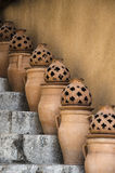 Pottery From Taormina. Lamps and pitchers decorating a staircase in Taormina Royalty Free Stock Image